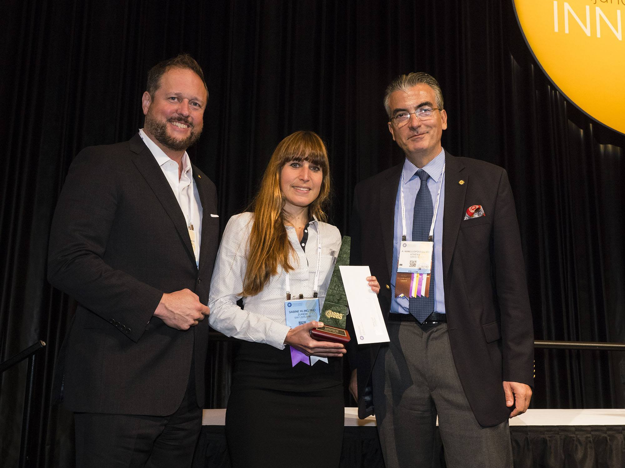 Dr. Kling receives the ISRS Troutman Award, with Prof. Kanellopoulos and Prof. Randleman